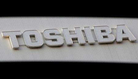 FILE PHOTO - A logo of Toshiba Corp is seen outside an electronics retail store in Tokyo
