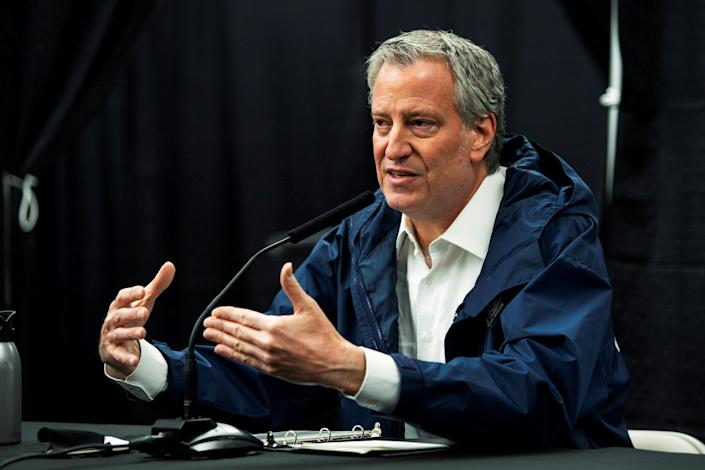 FILE PHOTO: New York City Mayor Bill De Blasio speaks to the media during a press conference In the Queens borough of New York City, New York, U.S., April 10, 2020. REUTERS/Eduardo Munoz
