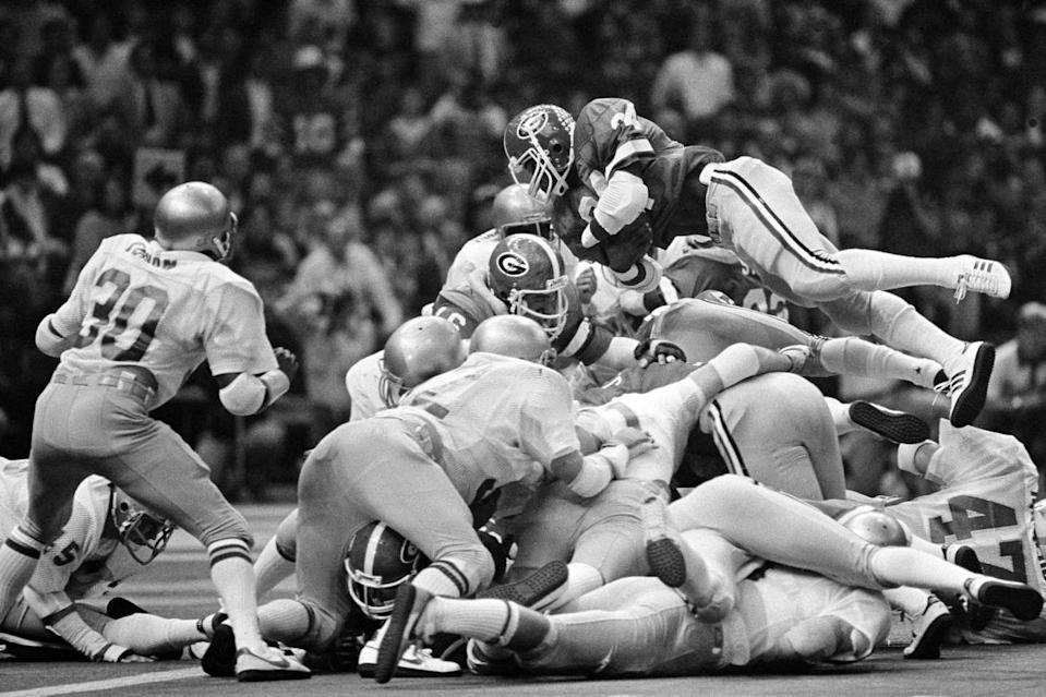 Georgia's Herschel Walker  goes above Notre Dame's defense to score a touchdown in the  Sugar Bowl on   Jan. 1, 1981. Walker scored twice as Georgia won the national championship.