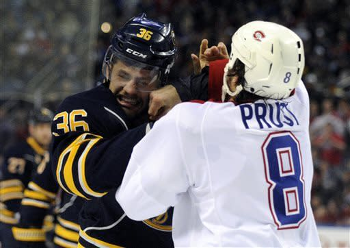 Buffalo Sabres' right winger Patrick Kaleta (36) is punched by Montreal Canadiens' left winger Brandon Prust (8) during a fight in the first period of an NHL hockey game in Buffalo, N.Y., Thursday, April 11, 2013. (AP Photo/Gary Wiepert)