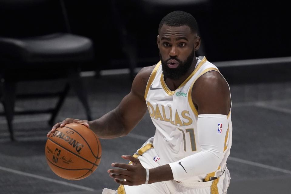 FILE - In this Feb. 12, 2021, file photo, Dallas Mavericks' Tim Hardaway Jr. moves to the basket during an NBA basketball game against the New Orleans Pelicans in Dallas. A person with knowledge of the deal says the Mavericks and Hardaway have agreed on a $72 million, four-year contract that will keep the shooting guard in Dallas. (AP Photo/Tony Gutierrez, File)