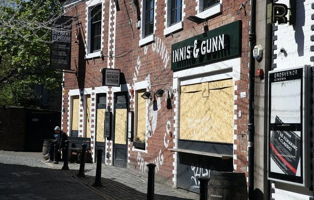 Boarded up restaurants and pubs in Glasgow (Andrew Milligan/PA)