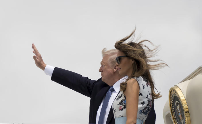 <p>President Donald Trump and First Lady Melania Trump board Air Force One at Orly Airport in Paris, Friday, July 14, 2017, en route to Bedminster, N.J., after attending the Bastille Day parade on the Champs Elysees avenue in Paris. (Photo: Carolyn Kaster/AP) </p>