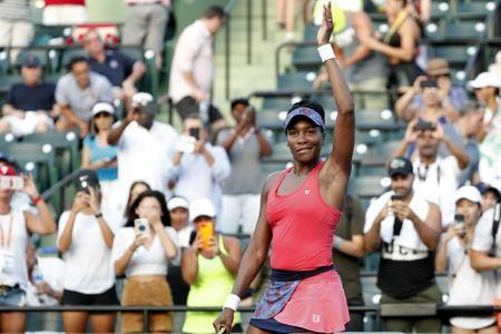 Mar 26, 2018; Key Biscayne, FL, USA; Venus Williams of the United States waves to the crowd after her match against Johanna Konta of Great Britain (not pictured) on day seven of the Miami Open at Tennis Center at Crandon Park. Williams won 5-7, 6-1, 6-2. Mandatory Credit: Geoff Burke-USA TODAY Sports