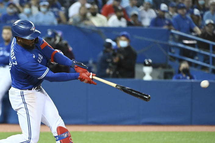 Toronto Blue Jays' Teoscar Hernandez hits a double in the fifth inning of a baseball game against the Tampa Bay Rays in Toronto on Monday, Sept. 13, 2021. (Jon Blacker/The Canadian Press via AP)