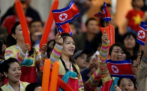 North Korean fans at a friendly football game against Vietnam in December - Credit: Nhac Nguyen/AFP