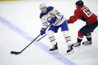 Buffalo Sabres right wing Sam Reinhart (23) skates with the puck past Washington Capitals left wing Carl Hagelin (62) during the second period of an NHL hockey game, Friday, Jan. 22, 2021, in Washington. (AP Photo/Nick Wass)