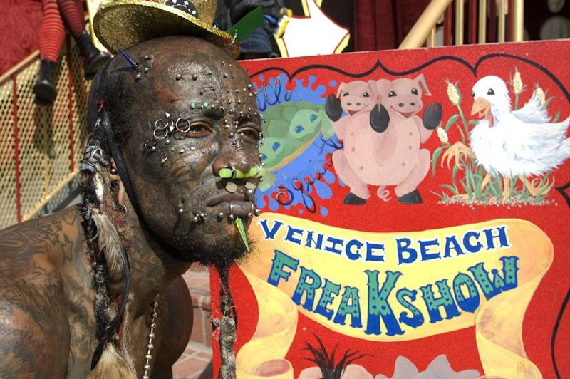"This publicity image released by AMC shows Creature waiting for passerbys to come see the Venice Beach Freakshow on the boardwalk of Venice Beach, Calif. ""Freakshow,"" is an unscripted series premiering Thursday at 9:30 p.m. EST on AMC. (AP Photo/AMC, Ron Jaffe)"