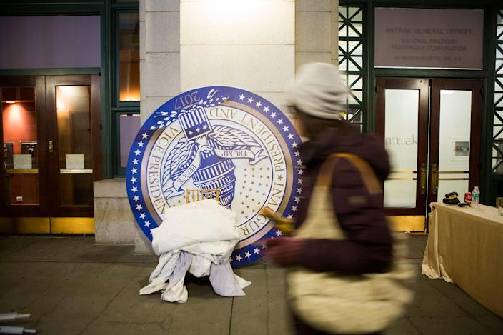 <p>A woman walks past a sign from an event last night at Union Station held in honor of the inauguration of Donald Trump later today on January 20, 2017 in Washington, DC. Today Trump is sworn in as the 45th president of the United States. (Photo: Jessica Kourkounis/Getty Images) </p>