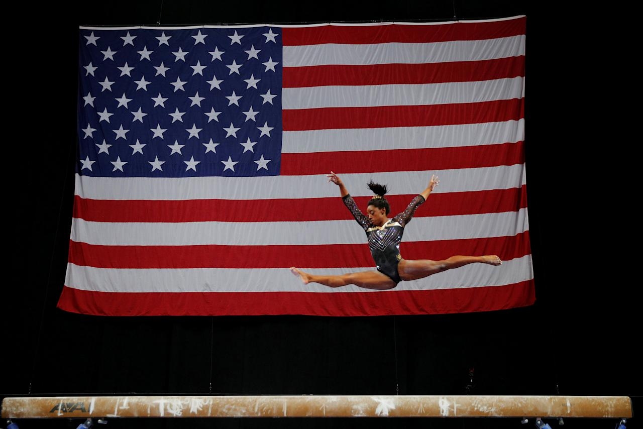Simone Biles competes on the balance beam at the U.S. Gymnastics Championships in Boston, Massachusetts, U.S., August 17, 2018.     REUTERS/Brian Snyder      TPX IMAGES OF THE DAY      TPX IMAGES OF THE DAY