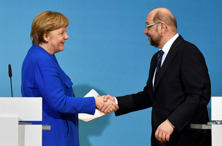 Merkel strikes preliminary deal to hold power in German coalition