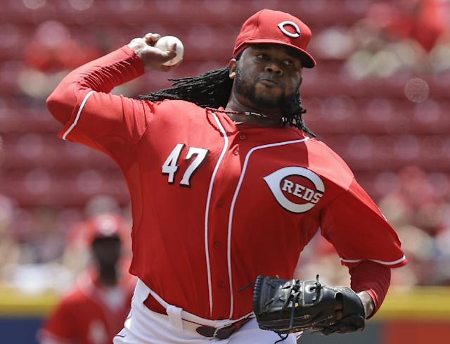 Cincinnati Reds starting pitcher Johnny Cueto throws against the Chicago Cubs in the first inning of a baseball game, Tuesday, July 8, 2014, in Cincinnati. (AP Photo/Al Behrman)