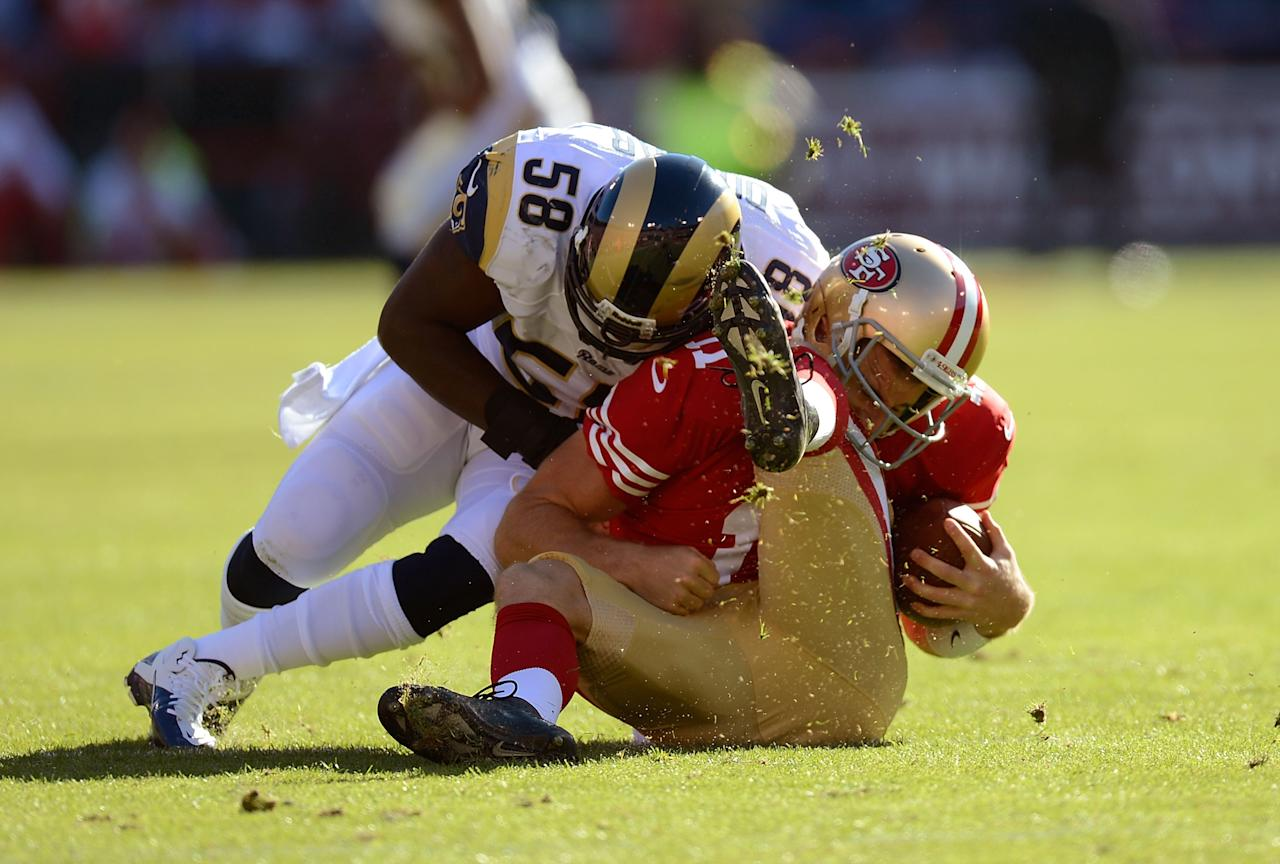SAN FRANCISCO, CA - NOVEMBER 11:  Alex Smith #11 of the San Francisco 49ers is hits hard by Jo-Lonn Dunbar #58 of the St. Louis Ram during the first quarter of their NFL football game at Candlestick Park on November 11, 2012 in San Francisco, California.  (Photo by Thearon W. Henderson/Getty Images)