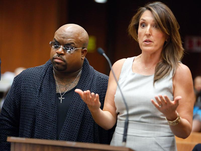 Singer Cee Lo Green, whose real name is Thomas DeCarlo Callaway, left, listens as attorney Blair Berk speaks during his arraignment at the Clara Shortridge Foltz Criminal Justice Center in downtown Los Angeles on Monday, Oct. 21, 2013. Green pleaded not guilty to giving a woman ecstasy at a Los Angeles restaurant during a 2012 dinner, and prosecutors declined to file a rape count against the singer because of insufficient evidence. The singer's bail was set at $30,000 and he is due back in court on Nov. 20, 2013. (AP Photo/Los Angeles Times, Mel Melcon, Pool)