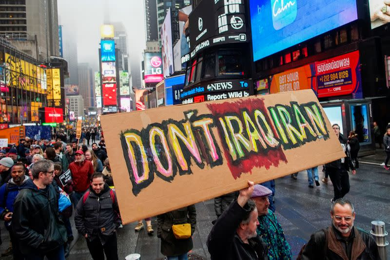 People march as they take part in an anti-war protest amid increased tensions between the United States and Iran at Times Square in New York