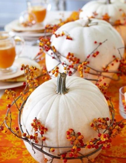 """<div class=""""caption-credit""""> Photo by: StyleCaster</div>We love the idea of dressing up a simple pumpkin by painting it. In lieu of traditional orange, white looks clean and dramatic against vibrant fall colors. A garland of red berries really polishes off the look. <br> Image Via Better Homes and Gardens"""