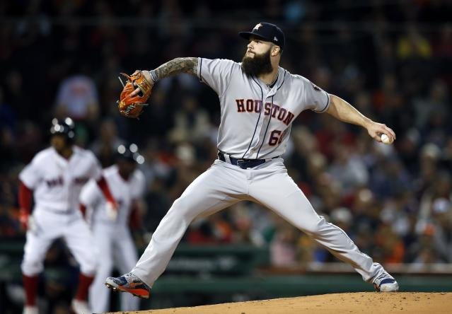 Houston Astros' Dallas Keuchel pitches during the first inning of a baseball game against the Boston Red Sox in Boston, Sunday, Sept. 9, 2018. (AP Photo/Michael Dwyer)