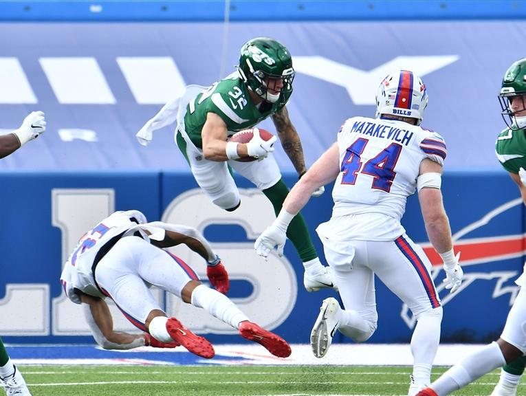 Sep 13, 2020; Orchard Park, New York, USA; New York Jets safety Ashtyn Davis (32) is upended by Buffalo Bills strong safety Dean Marlowe (31) on a kickoff return in the fourth quarter at Bills Stadium. Mandatory Credit: Mark Konezny-USA TODAY Sports