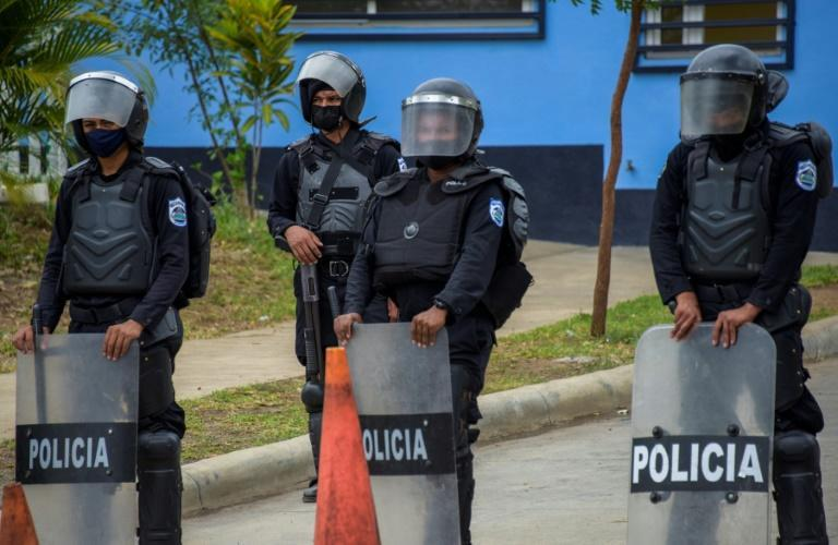 Riot police stand guard outside El Chipote on June 30, 2021