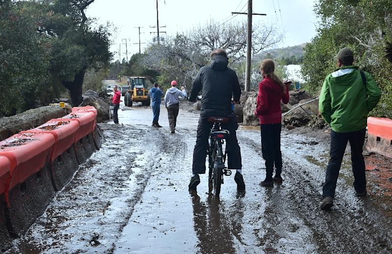 Residents survey damage from mudslides in California which killed at least 15 people (AFP Photo/FREDERIC J. BROWN)