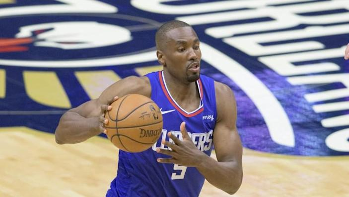 Los Angeles Clippers center Serge Ibaka (9) dribbles in the first half of an NBA basketball game.