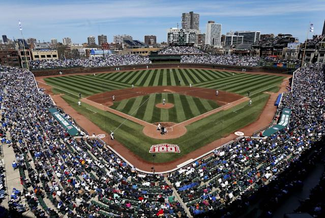 Baseball fans are seen at the 100th anniversary of the first baseball game at Wrigley Field between the Arizona Diamondbacks and Chicago Cubs, Wednesday, April 23, 2014, in Chicago. (AP Photo/Charles Rex Arbogast)