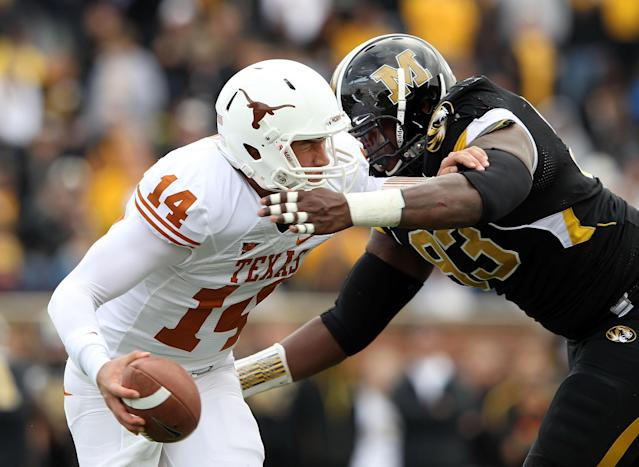 COLUMBIA, MO - NOVEMBER 12: Quarterback David Ash #14 of the Texas Longhorns is sacked by Terrell Resonno #93 of the Missouri Tigers during the game on November 12, 2011 at Faurot Field/Memorial Stadium in Columbia, Missouri. (Photo by Jamie Squire/Getty Images)