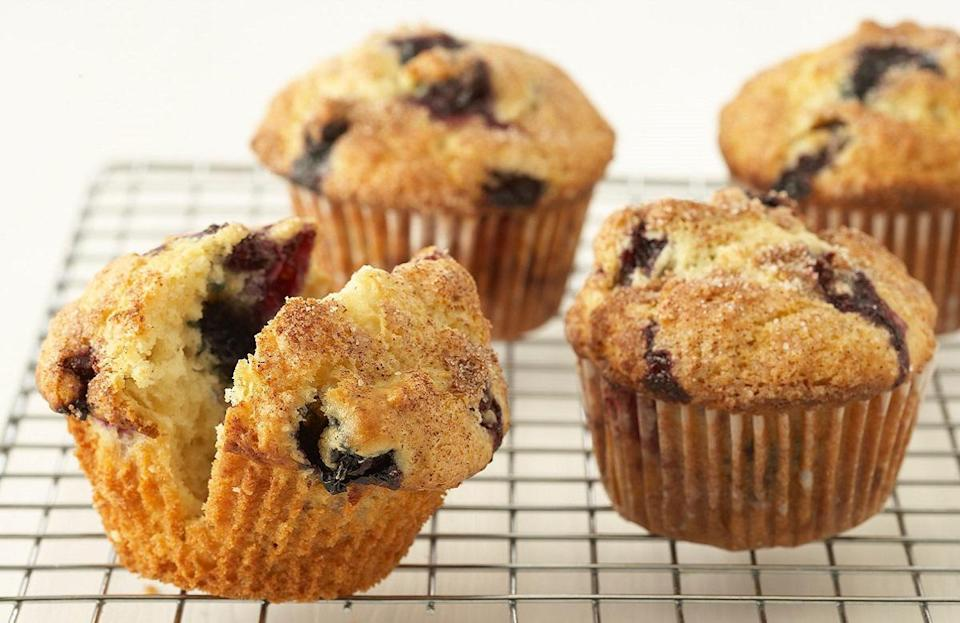 """<p>Blueberry muffins are a classic <a href=""""https://www.thedailymeal.com/cook/nostalgic-childhood-desserts?referrer=yahoo&category=beauty_food&include_utm=1&utm_medium=referral&utm_source=yahoo&utm_campaign=feed"""" rel=""""nofollow noopener"""" target=""""_blank"""" data-ylk=""""slk:childhood dessert you've probably forgotten"""" class=""""link rapid-noclick-resp"""">childhood dessert you've probably forgotten</a>. But allow this recipe to remind you of their glory, which is only amplified with fresh, in-season berries.</p> <p><a href=""""https://www.thedailymeal.com/recipes/blueberry-muffins-recipe-0?referrer=yahoo&category=beauty_food&include_utm=1&utm_medium=referral&utm_source=yahoo&utm_campaign=feed"""" rel=""""nofollow noopener"""" target=""""_blank"""" data-ylk=""""slk:For the Blueberry Muffins recipe, click here."""" class=""""link rapid-noclick-resp"""">For the Blueberry Muffins recipe, click here.</a></p>"""