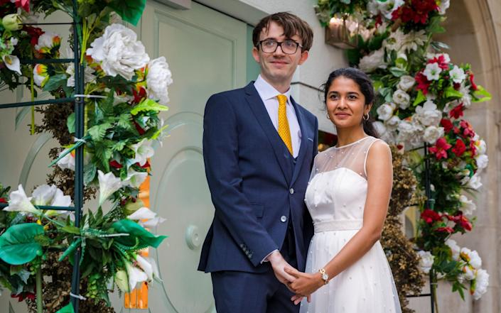 James Travers (L) and Stuthi Srinavasan (R) in Kings Road after their wedding at Chelsea Town Hall, London, Britain, 04 July 2020. - Vickie Flores/EPA-EFE/Shutterstock