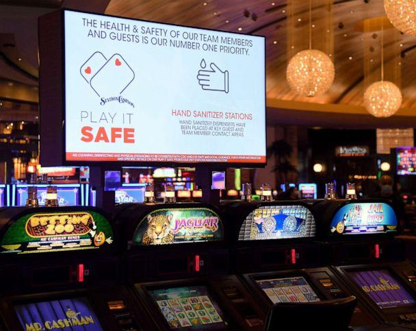PHOTO: A monitor above a row of slot machines displays COVID-19 safety messages at the Red Rock Resort, which has been closed since March 17 because of the coronavirus pandemic as the property prepares to open on June 3, 2020 in Las Vegas. (Ethan Miller/Getty Images)