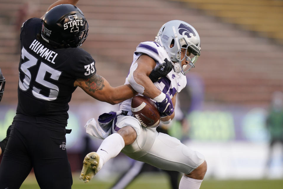 Iowa State linebacker Jake Hummel (35) breaks up a pass intended for Kansas State running back Deuce Vaughn, right, during the first half of an NCAA college football game, Saturday, Nov. 21, 2020, in Ames, Iowa. (AP Photo/Charlie Neibergall)