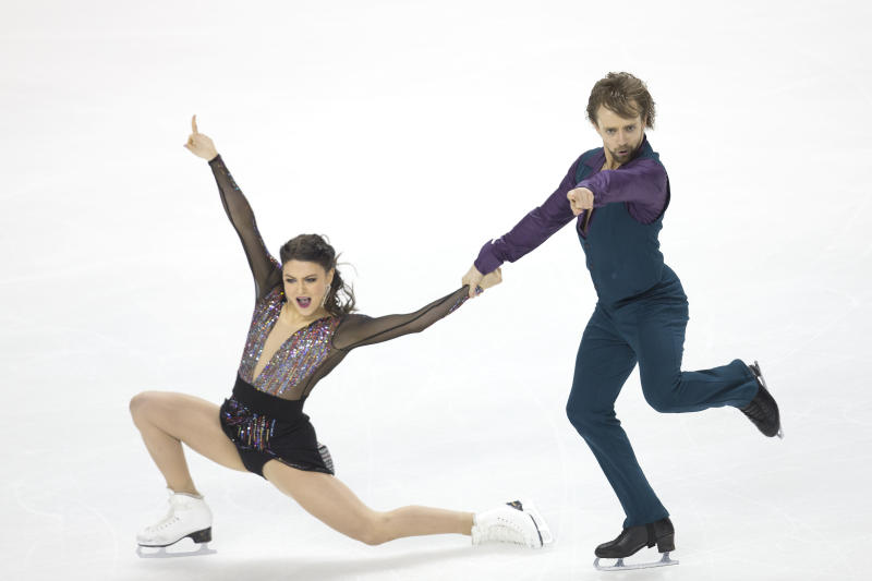 Kaitlin Hawayek and Jean-Luc Baker compete in the senior rhythm dance short program at the U.S. Figure Skating Championships, Friday, Jan. 24, 2020, in Greensboro, N.C. (AP Photo/Lynn Hey)