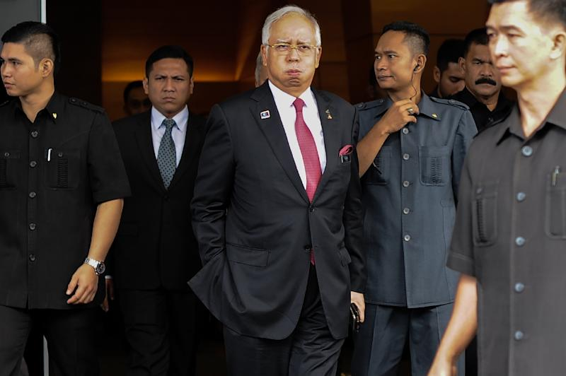 Since 2015, Najib Razak's (C) government has arrested whistleblowers and moved to muzzle media outlets who reported on scandals (AFP Photo/Mohd Rasfan)