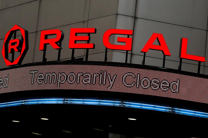 'Temporarily Closed' is displayed on the marquee of a Regal theatre during the outbreak of the coronavirus disease (COVID-19), in New York City, U.S., April 29, 2020. REUTERS/Brendan McDermid