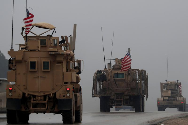 A picture taken on December 30, 2018, shows a line of US military vehicles in Syria's northern city of Manbij.