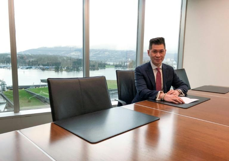 Canadian lawyer and royal commentator Edward Wang talks to AFP in his office overlooking Vancouver harbor on January 24, 2020