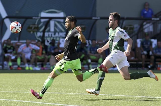 Seattle Sounders' Lamar Neagle, left, vies for control of the ball against Portland Timbers' Danny O'Rourke, right, during an MLS soccer game in Portland, Ore., Sunday, Aug. 24, 2014. (AP Photo/Natalie Behring)