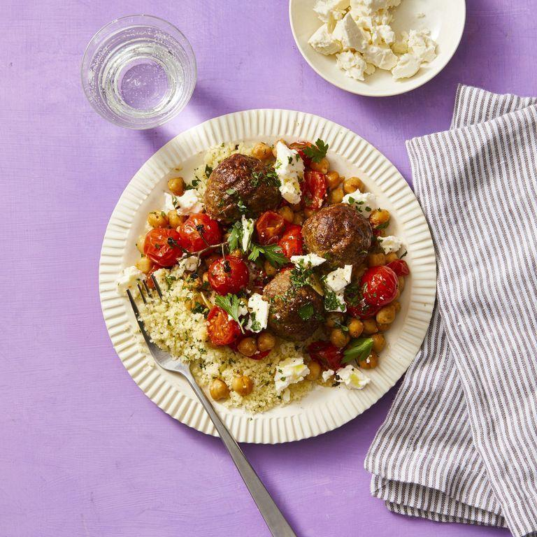 """<p>Serve these Moroccan meatballs with couscous and feta for a flavor that will take you on a journey. </p><p><em><a href=""""https://www.womansday.com/food-recipes/food-drinks/a29845554/moroccan-meatballs-with-roasted-tomatoes-and-chickpeas-recipe/"""" rel=""""nofollow noopener"""" target=""""_blank"""" data-ylk=""""slk:Get the Moroccan Meatballs with Roasted Tomatoes and Chickpeas recipe."""" class=""""link rapid-noclick-resp"""">Get the Moroccan Meatballs with Roasted Tomatoes and Chickpeas recipe. </a></em></p>"""