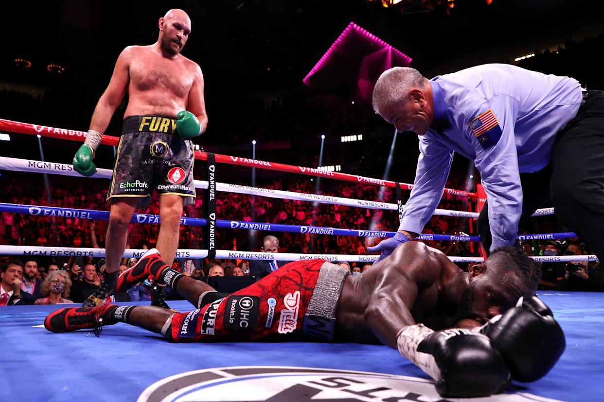 LAS VEGAS, NEVADA - OCTOBER 09: Tyson Fury (top) knocks out Deontay Wilder in the 11th round during their WBC heavyweight title fight at T-Mobile Arena on October 09, 2021 in Las Vegas, Nevada. (Photo by Al Bello/Getty Images)