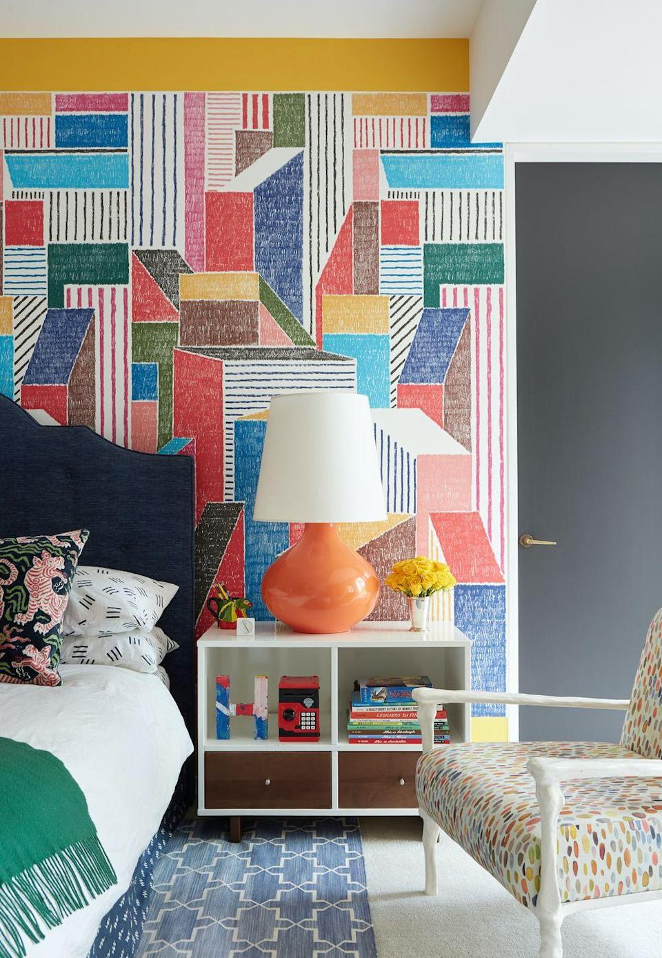 """<p>Nick Olsen brought a Hollywood spirit to this Cincinnati home with bold pops of color. """"I love high style mixed with something ordinary or strange,"""" <a href=""""https://www.elledecor.com/design-decorate/house-interiors/a30678139/nick-olsen-cincinnati-house/"""" rel=""""nofollow noopener"""" target=""""_blank"""" data-ylk=""""slk:he told ELLE Decor"""" class=""""link rapid-noclick-resp"""">he told <em>ELLE Decor</em></a>. """"My style owes heavily to the decorating greats, but I combine elements in a way that feels fresh to me and, hopefully, conveys a sense of humor.""""</p><p><em>Cole and Son Prism Multi Colored Wallpaper, $137 <br></em> <a class=""""link rapid-noclick-resp"""" href=""""https://www.wallpaperstogo.com/p-143815-prism-multi-coloured-wallpaper.aspx?gclid=CjwKCAiArIH_BRB2EiwALfbH1PRGbsmp4-qKWnyyhlqHV2puoV2ZQmeyOzguTkxNf2oT5_5uNE90GRoCo9sQAvD_BwE"""" rel=""""nofollow noopener"""" target=""""_blank"""" data-ylk=""""slk:Shop the Look"""">Shop the Look</a></p>"""