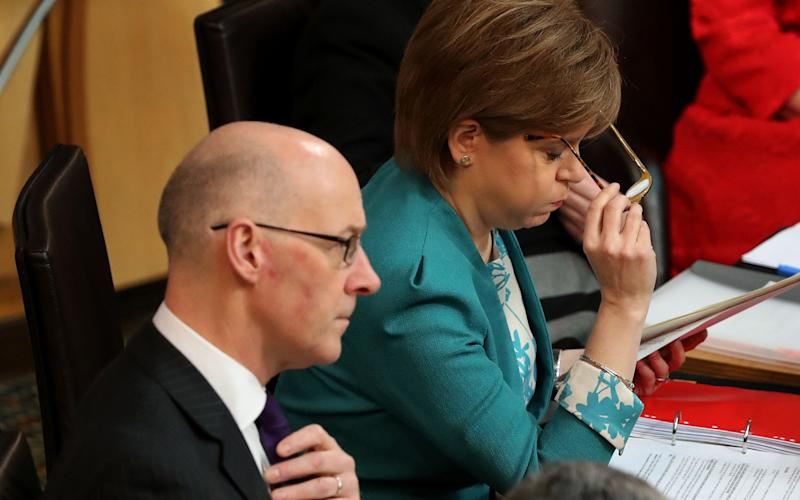 John Swinney and Nicola Sturgeon have been forced to completely overhaul their Named Person scheme - PA