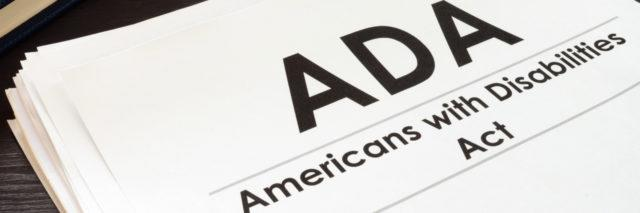 Americans with Disabilities Act paper next to keyboard.