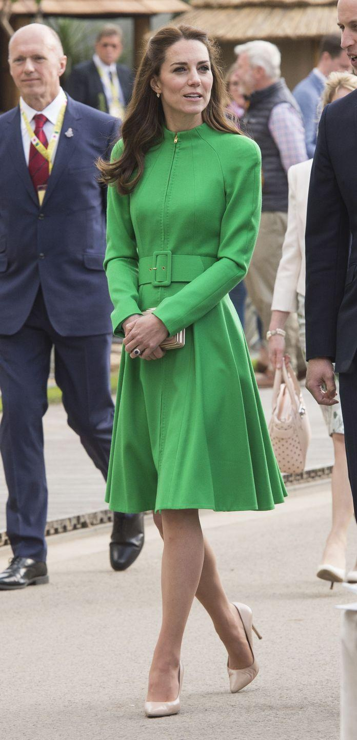 <p>Kate stopped to smell the roses at the Chelsea Flower Show in London with other members of the royal family in the green Catherine Walker. </p>
