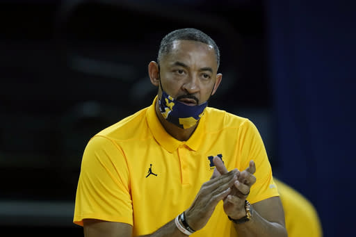 Michigan coach Juwan Howard watches from the sideline during the first half of the team's NCAA college basketball game against Wisconsin, Tuesday, Jan. 12, 2021, in Ann Arbor, Mich. (AP Photo/Carlos Osorio)