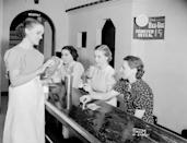 <p>Three young ladies visiting a Wisconsin ice cream parlor order up the special 15-cent milkshake. Today, that milkshake would set you back approximately $2.80.</p>