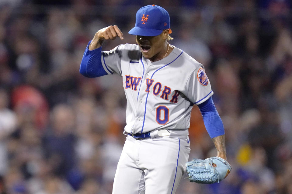 New York Mets starting pitcher Marcus Stroman celebrates after catcher Tomas Nido turned a bases-loaded double play in the third inning of a baseball game against the Boston Red Sox at Fenway Park, Tuesday, Sept. 21, 2021, in Boston. (AP Photo/Charles Krupa)