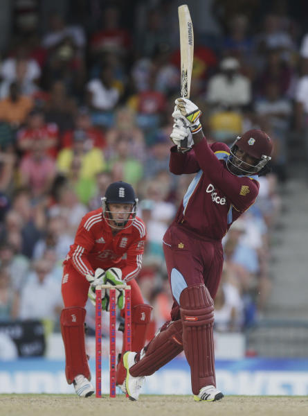 West Indies' Chris Gayle hits a six during the second T20 International cricket match against England at the Kensington Oval in Bridgetown, Barbados, Tuesday, March 11, 2014. (AP Photo/Ricardo Mazalan)