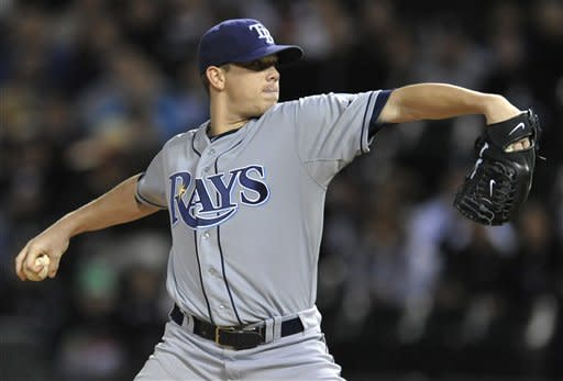 Tampa Bay Rays starter Jeremy Hellickson delivers a pitch in the first inning during a baseball game against the Chicago White Sox in Chicago, Friday, Sept. 28, 2012. (AP Photo/Paul Beaty)