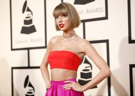 Taylor Swift arrives at the 58th Grammy Awards in Los Angeles