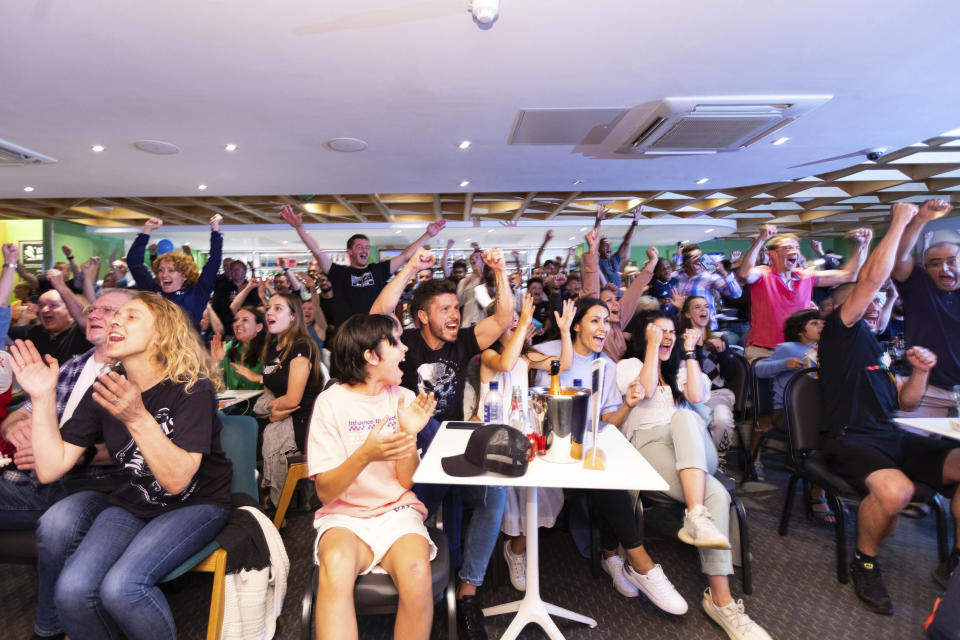 People watching remotely celebrate after British teenager Emma Raducanu beat Canadian teenager Leylah Fernandez in the U.S. Open final at The Parklangley Club, in Beckenham, England, Saturday, Sept. 11, 2021. Raducanu beat Fernandez 6-4, 6-3 in the U.S. Open final to become the first qualifier to win a Grand Slam title in the professional era. (David Parry/PA via AP)
